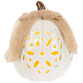 cream lighted pumpkin decor with cutouts and burlap